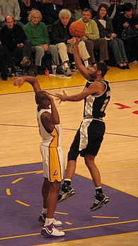 Duncan going up for a shot over the Lakers' Andrew Bynum.