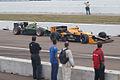 Takuma Sato follows Simona De Silvestro off pit road Morning Practice SPGP 28March2010 (14513077017).jpg