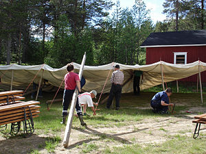 Communal work - A tent is being raised on talkoot for midsummer in Ylimuonio 2005.