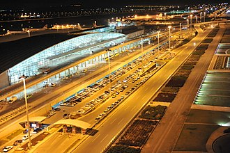 Entrance of the Khomeini Airport in 2008. Tehran IKIA at Night.jpg