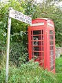 Telephone box and fingerpost at North Stoke, in Amberley, West Sussex, England..jpg