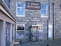 Telephone box outside C. Kelly Opticians - geograph.org.uk - 960415.jpg