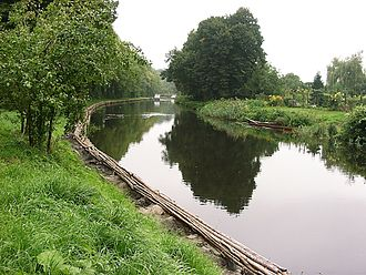 Fascine - Templin Channel in Templin, Germany. The riverbank was strengthened with fascines.