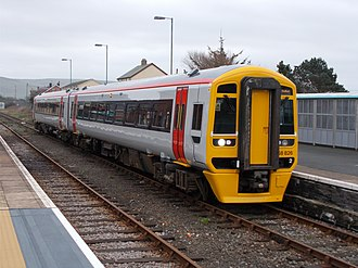 Cambrian Line - Freshly painted and without branding, Transport for Wales class 158 at Tywyn station, making the 11:30 service to Pwllheli on 21st of February 2019