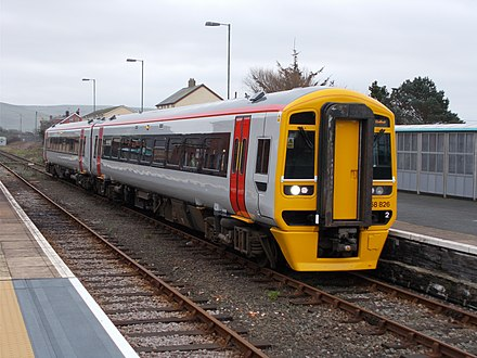 Freshly painted and without branding, Transport for Wales class 158 at Tywyn station, making the 11:30 service to Pwllheli on 21 February 2019 TfW class 158 Tywyn.jpg