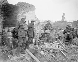 King's Own Yorkshire Light Infantry - Troops of the 12th (Service) Battalion, KOYLI break for food amdist the ruins of Feuchy, April 1917.
