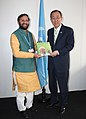 The Minister of State for Environment, Forest and Climate Change (Independent Charge), Shri Prakash Javadekar presenting the book on Climate Change authored by the Prime Minister, Shri Narendra Modi.jpg
