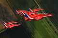 The Red Arrows are pictured as they fly in tight formation during display training MOD 45147903.jpg