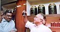 The Union Minister of State for Commerce, Shri Jairam Ramesh inspects samples of export-quality green tea after inaugurating a Tea boutique in Kolkata on March 18, 2007.jpg