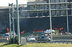 The pentagon in flames moments after a hijacked jetliner crashed into building at approximately 0930 010911-M-CI426-014.jpg
