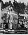 Totem poles and houses at Alert Bay VPL 4869.jpg