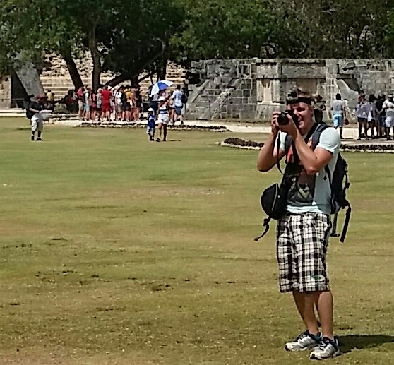 Tourist taking photographs and video at archaelogical site