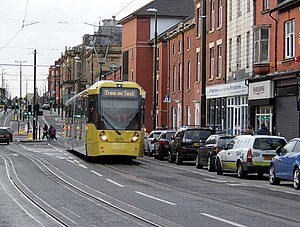 Oldham and Rochdale Line - A M5000 tram running through Union Street, on the Oldham town centre line opened in January 2014.