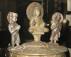 The Buddha venerated by Indra and Brahma, Kanishka casket, dated to 127 CE, British Museum.