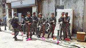 Macau Garrison - PLA Macau Garrison troops cleaning Macau streets.