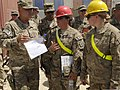 U.S. Army Maj. Gen. Kurt Stein, left, the commander of the 1st Sustainment Command, and Col. Charles Hamilton discuss projects with Soldiers assigned to the 557th Engineer Company, 864th Engineer Battalion 130611-A-KO462-093.jpg