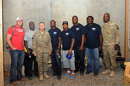 Miller (third from right) was one of several NFL players who visited US Army soldiers in Afghanistan during the 2013 offseason. U.S. Army Maj. Gen. Robert Abrams the commanding officer of Regional Command-South and Third Infantry Division, and Command Sgt. Maj. Edd Watson, Third Infantry Division and Regional Command-South senior 130319-A-VM825-497.jpg