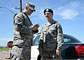 U.S. Army Sgt. Anthony Jones, left, with the 145th Mobile Public Affairs Detachment, interviews Air Force Airman 1st Class James Moore, with the 137th Air Refueling Wing security force, while he takes a break 130522-Z-TK779-023.jpg