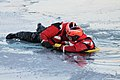 U.S. Coast Guard Seaman Michael Holmes, left, gives instructions to Seaman Jekeydon Pratcher as he is pulled out of the water during a training scenario in Milwaukee, Wis., Jan. 15, 2013 130115-G-XQ144-002.jpg
