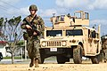 U.S. Marine Corps 1st Lt. Christopher A. Meadows, a ground intelligence officer assigned to the 3rd Marine Division, III Marine Expeditionary Force, guides a Humvee through an entry control point during Yama 120126-M-HU778-039.jpg
