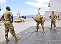 U.S. Marine Corps Capt. Chris Tucker, and Sgt. Gabriel Perez, center, assigned to Fleet Antiterrorism Security Team Pacific (FASTPAC), perform mixed martial arts techniques under the supervision of Sgt. William 130528-N-QD718-114.jpg