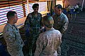U.S. Marines with the civil-military affairs section of Marine Corps Forces Central Command (Forward) speak with Royal Jordanian Army 2nd Lt. Zayed Alkhwalden, second from left, the civil affairs officer with 130609-M-UV027-088.jpg