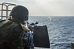 U.S. Navy Electronics Technician 3rd Class Dillon Fair fires an M240B machine gun during a live-fire exercise aboard the amphibious transport dock ship USS Denver (LPD 9) March 10, 2014, in the East China Sea 140310-N-ZU025-092.jpg