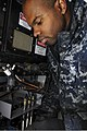 U.S. Navy Fire Controlman 2nd Class Perry Kendrick works on a close-in weapons system aboard the aircraft carrier USS Nimitz (CVN 68) 130125-N-SM403-045.jpg