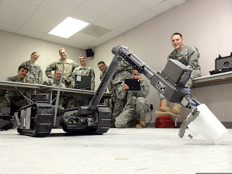 File:U.S. Sailors and Soldiers with the Farah Provincial Reconstruction Team (PRT) watch as Army Staff Sgt. Ryan Long, seated third from left, picks up a cup using an iRobot PackBot 510 robot during counterimprovised 120903-N-IE116-001.jpg