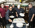 U.S. Sailors gather for cake during a Lesbian, Gay, Bisexual and Transgender Pride Month observance aboard the guided missile cruiser USS Philippine Sea (CG 58) June 30, 2014, in the Persian Gulf 140630-N-PJ969-046.jpg
