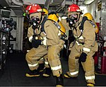 U.S. Sailors participate in a general quarters drill aboard the aircraft carrier USS John C. Stennis (CVN 74) in U.S. 5th Fleet area of responsibility Jan. 24, 2013 130124-N-YW024-025.jpg