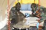 U. S. Marine passes through a decontamination station during chemical, biological, radiological and nuclear assessment and consequence management training at Marine Corps Air Station Futenma Japan Aug. 31, 2012 120831-M-GX379-284.jpg