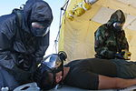 U. S. Marines pass through a decontamination station during Chemical, Biological, Radiological, and Nuclear Assessment and Consequence Management training at Marine Corps Air Station Futenma Japan Aug 31, 2012 120831-M-GX379-295.jpg