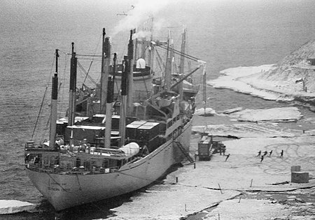 Severe cracks in an ice pier in use for four seasons at McMurdo Station slowed cargo operations in 1983 and proved a safety hazard. USNS Southern Cross at the ice pier in 1983.jpg