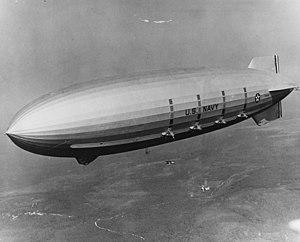 The U.S. Navy airship USS Macon (ZRS-5) conduc...