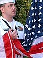 US Navy 020911-N-0000P-001 Raising the flag during morning colors.jpg