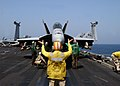 "US Navy 021005-N-9593M-032 A flight deck Leading Chief Petty Officer (LCPO) directs an F-A-18E Super Hornet assigned to the ""Eagles"" of Strike Fighter Squadron One One Five (VFA-115) to a catapult.jpg"