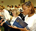 US Navy 021104-N-5576W-002 Recruits inventory and read a passage out of their freshly issued Blue Jackets manual.jpg