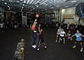 US Navy 030311-N-4048T-020 Sailors and Marines participate in a 3 on 3 basketball tournament in the hangar bay aboard the amphibious assault ship USS Kearsarge (LHD 3).jpg