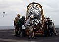 US Navy 030328-N-7265L-063 The supply department crew aboard USS Carl Vinson (CVN 70) pull a jet engine out of the landing area.jpg