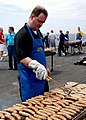 US Navy 030420-N-0923G-088 Mess Specialist 2nd Class Steven Adams prepares sausages for a Steel Beach Picnic.jpg