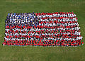 US Navy 030513-N-2069B-001 Students and faculty from both Akers and R.J. Neutra Elementary Schools aboard the Naval Air Station Lemoore, Calif., show their appreciation for the members of the U.S. military.jpg