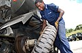 US Navy 030710-N-1485H-001 Equipment Operator Constructionman Joseph Brown from Seaside, Calif. changes out a tire on a water truck.jpg