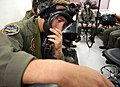 US Navy 030829-N-1755G-003 Aviation Electronics Technician 1st Class Jeff Siegfried, from Boise, Idaho, checks his oxygen mask before beginning a test in the low pressure chamber at the Aviation Survival Training Center.jpg