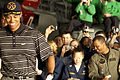 US Navy 040303-N-5319A-016 Crewmembers photograph professional golfer Tiger Woods as he walks through the hanger bay of the nuclear powered aircraft carrier USS George Washington (CVN 73).jpg