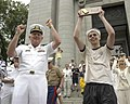 US Navy 040520-N-9693M-016 Vice Adm. Rodney Rempt, Superintendent of the U.S. Naval Academy, cheers with Midshipman Fourth Class Philip Johnson following the Herndon Monument climb held at the U.S. Naval Academy.jpg