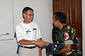 US Navy 050316-N-6665R-021 Senior Medical Officer of Project HOPE, Dr. George Holt, left, shake hands with Indonesian Army Colonel Dr. Dedy Achdiat Dasuki, thanking him for allowing the Military Sealift Command (MSC) hospital s.jpg