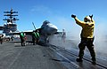 US Navy 050519-N-8148A-050 An aircraft director signals an F-A-18F Super Hornet, assigned to te Flying Eagles of Strike Fighter Squadron One Two Two (VFA-122), to approach the catapult for launch.jpg