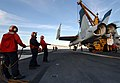 US Navy 051105-N-5345W-015 Crash and salvage personnel keep an F-A-18 Hornet training airframe steady as it is lifted from the landing area during a simulated crash landing training evolution aboard the Nimitz-class aircraft ca.jpg