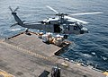 US Navy 051217-N-2259V-008 An SH-60 Seahawk helicopter delivers needed supplies to the flight deck of the amphibious assault ship USS Tarawa (LHA 1).jpg